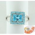 Серебряное кольцо с синтетическим топазом и фианитами