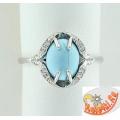 Серебряное кольцо с синтетической бирюзой и фианитами