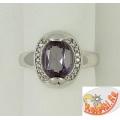 Серебряное кольцо с александритом и цирконами