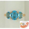Серебряное кольцо в позолоте с топазами