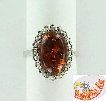 Серебряное кольцо с янтарем и марказитами